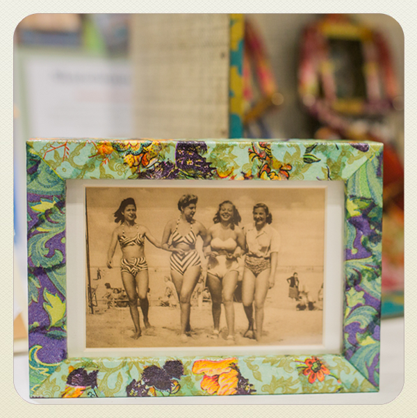 photo frame decoupaged with green, blue and orange paper